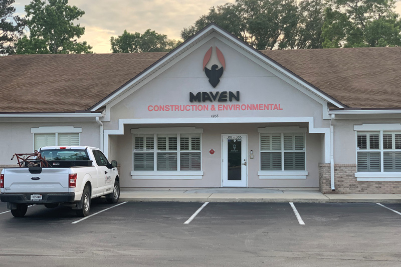 Maven construction & environmental sign on side of building